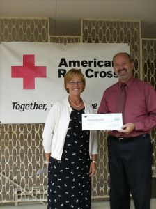 Our CEO, Cheryl Bremer, with Gary Gunnett of Awareness Home Funding.