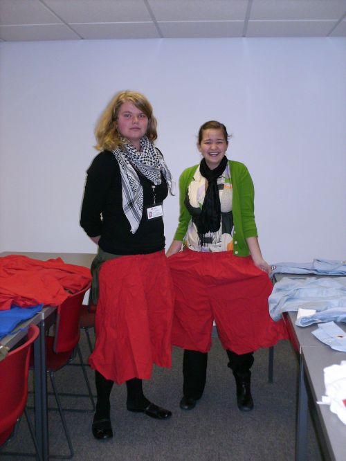 Cassidhe and Amanda model some of the large stack of awkward red, poofy pants that were unearthed. We're thinking...new staff uniforms?